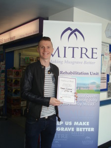 Gary presents MITRE with a cheque for £500
