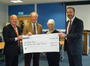 LEDCOM's Chairman Henry Fletcher and chief executive Ken Nelson present a cheque for £250 to Professor James Nixon and Pam Anstey of the MITRE Trust.
