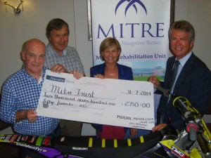 Billy McLarnin and George Porter from Mourne Motorcycle Club, with Patricia Humphreys and Terry Loughins from MITRE Trust
